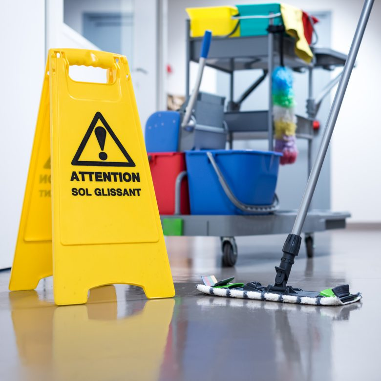 Worker janitor Mopping Floor In Office with trolley